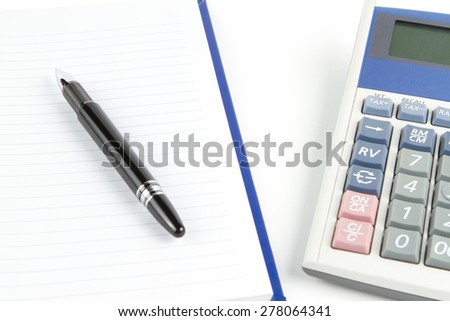 Notebook with black pen and calculator  - stock photo