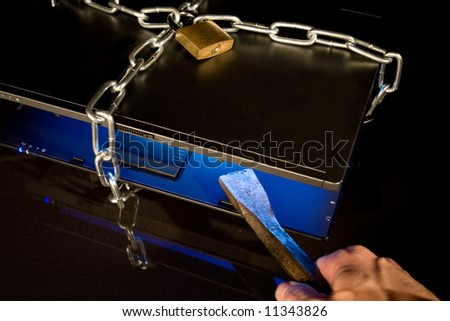 notebook with chain, padlock and crowbar on black background - stock photo