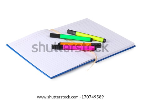 notebook with colored markers  on white background - stock photo