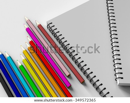 notebook with colored pencils on White background, stationary object