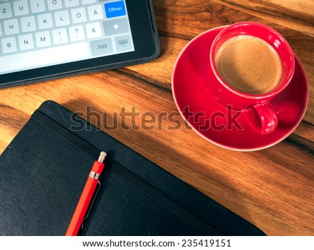 Notebook with espresso cup and tablet - stock photo