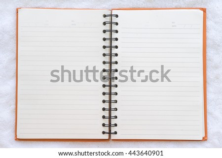notebook with fabric background, Top view
