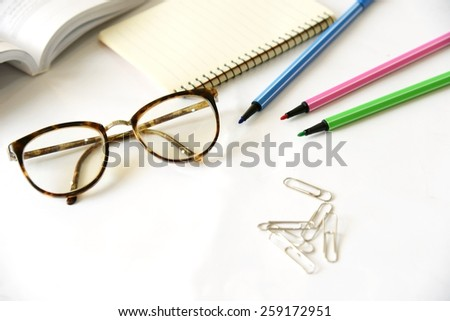 Notebook with glasses and pen on table, close up - stock photo