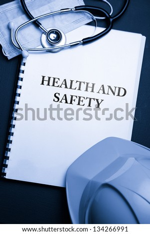 Notebook with helmet and stethoscope - stock photo