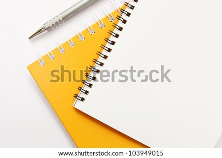 notebook with pen on white background - stock photo