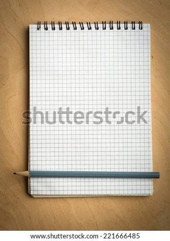 notebook with pencile on a wood background - stock photo