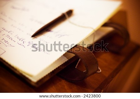 Notebook with signs and pen - stock photo