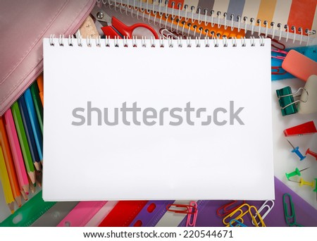 Notebook with stationary objects, copyspace