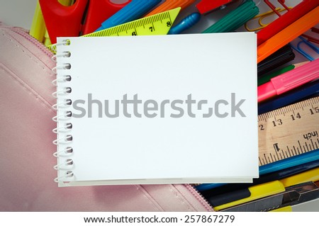 Notebook with stationary objects, copyspace - stock photo