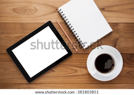 Notebook with tablet and pen on wooden table. Empty space on tablet - stock photo