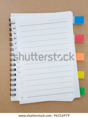 Notebook with Tag on wood background
