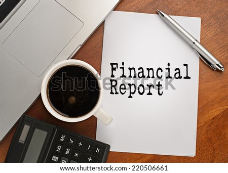 Notebook with text Financial report  on table with coffee, calculator and notebook  - stock photo