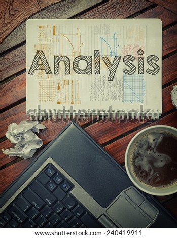 Notebook with text inside Analysis on table with coffee, laptop pc and crumpled sheets - stock photo