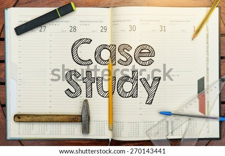 notebook with the note in the center about Case Study - stock photo