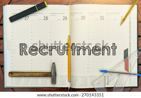 notebook with the note in the center about Recruitment - stock photo