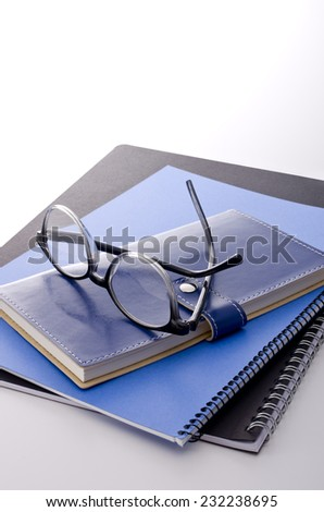 notebooks and glasses - stock photo