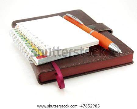 stock-photo-notebooks-and-pen-over-white