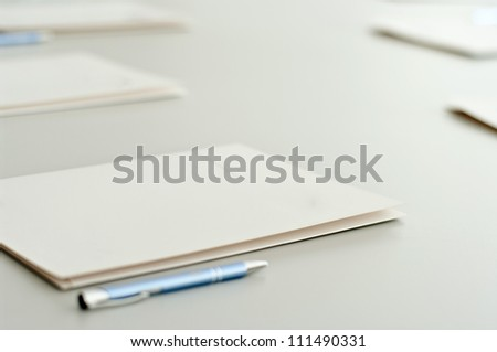 notebooks and pens on table. - stock photo