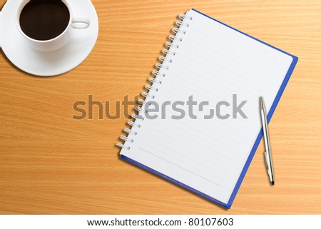 Notebooks, pens, coffee on the table - stock photo