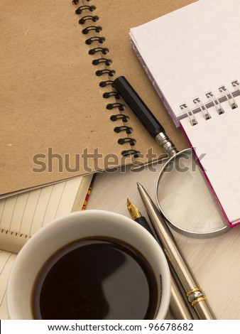 notebooks with cup of coffee