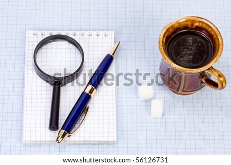 notepad and cup with coffee - stock photo