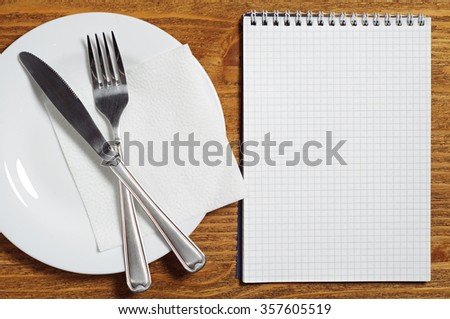 Notepad and cutlery. You can use as a template for a menu of cafes and restaurants