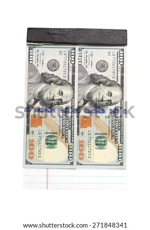 notepad and dollar bills on a white background
