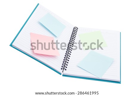 Notepad and flower isolated on white background - stock photo