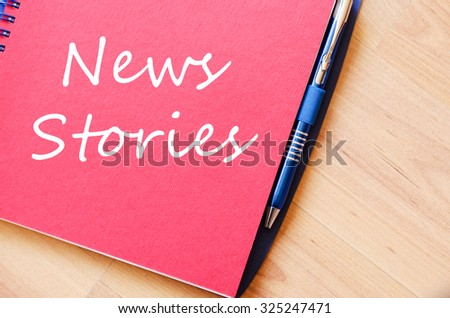 Notepad and pen on wooden background and text concept - stock photo