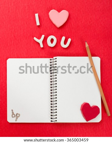 Notepad and pencil with love over red background. Top view with copy space, Valentines day - stock photo