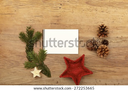 Notepad, fir twig and cones on wood - stock photo