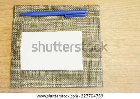 Notepad on table and pen  - stock photo