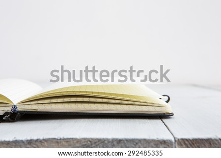 Notepad on white old wooden background