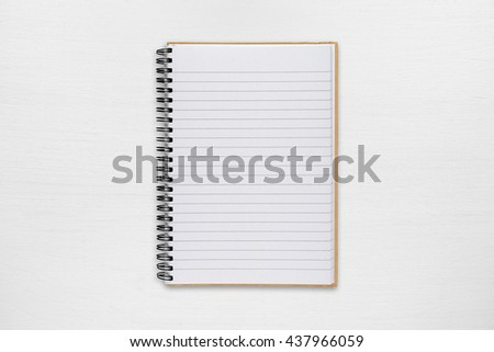 Notepad on white table - stock photo
