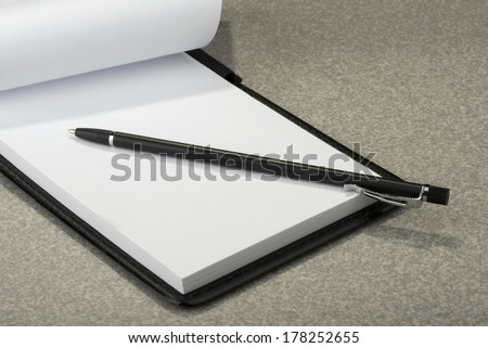 Notepad - pen and plain white paper - stock photo