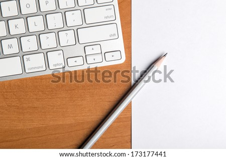 Notepad Pencil and Computer Laptop - stock photo
