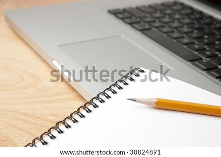 Notepad Pencil and Computer Laptop