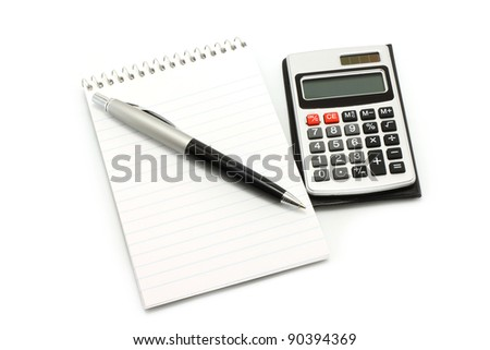 Notepad with ball pen and calculator on a white background