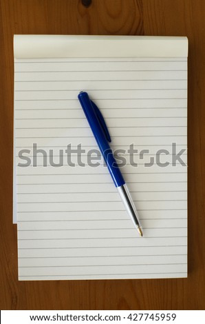 Notepad with pen - stock photo