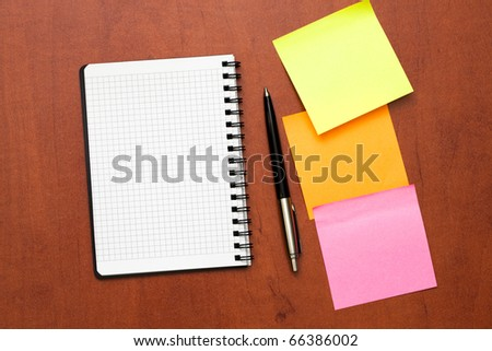 notepad with pen and reminder notes lying on the table - stock photo