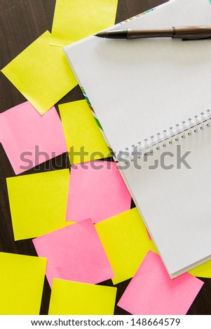 notepad with pen and reminder notes on the table.view on top - stock photo