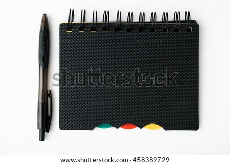 notepad with pen isolated on white background - stock photo