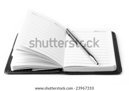 notepad with pen on a white background