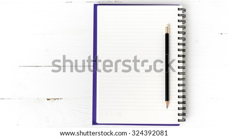 notepad with pen on white table - stock photo