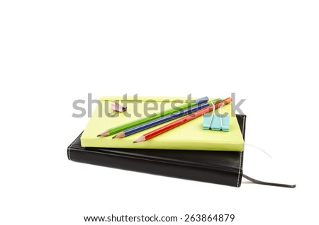 Notepad with pencil on white background - stock photo