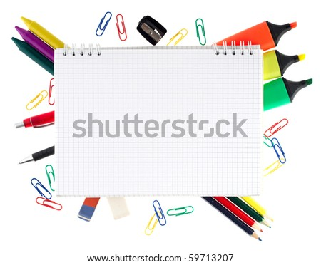 Notepad with stationary objects on white background - stock photo