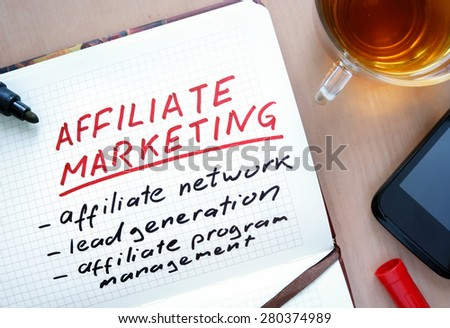 Notepad with words Affiliate marketing  concept and marker. - stock photo