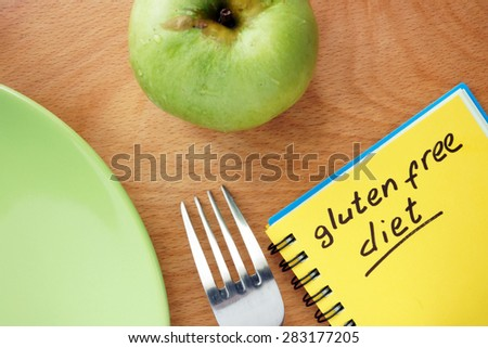 Notepad with words gluten free diet  - stock photo