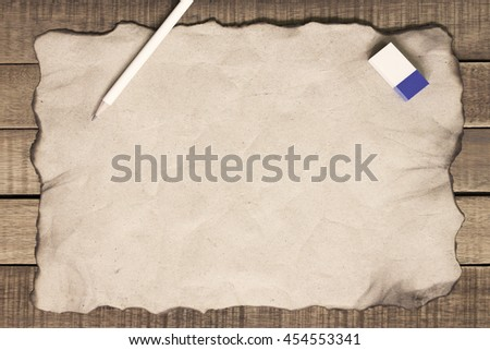 notepaper and pencil on wooden background. - stock photo