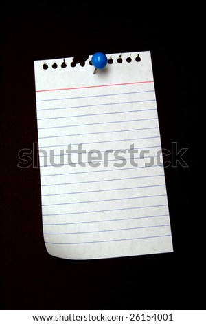 Notepaper tacked with blue pushpin